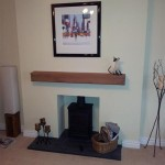 Smooth lined chamber, honed slate hearth, oak beam