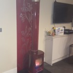 Red enamel stove and flue, red glass back panel