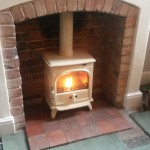 Original brick chamber, quarry tiled hearth, Dovre 250 enamel stove