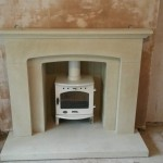Bosworth sandstone fireplace with a Carron 4.7 enamel stove