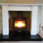 Claremont marble surround, black granite hearth, reeded vermiculite chamber and a Dean Forge Hembury 8