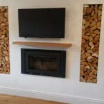 A nice big inset stove with tv above