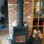 Black twinwall flue, reclaimed brick slips & quarry tile hearth