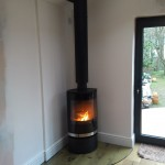 Fitted in a new kitchen extension with a glass quadrant hearth