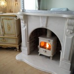 Fitted in a reclaimed marble surround